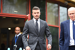 Football star David Beckham leaving Bromley Magistrates Court in south east London where he was disqualified for six months after receiving six points for using his mobile phone while driving his Bentley in London's West End.