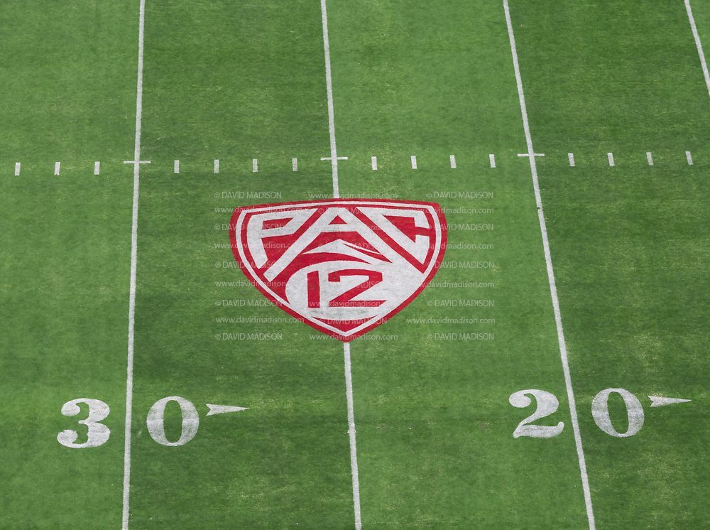 PALO ALTO, CA - SEPTEMBER 26:  A high angle view of the Pac-12 logo on the field at Stanford Stadium during an NCAA Pac-12 college football game between the Stanford Cardinal and the UCLA Bruins on September 26, 2021 in Palo Alto, California.  (Photo by David Madison/Getty Images)