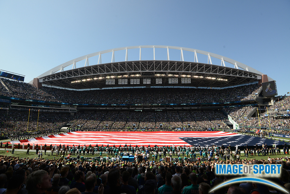 Sep 11, 2016; Seattle, WA, USA; General view of United States flag on the field during the playing of the national anthem during a NFL game between the Miami Dolphins and the Seattle Seahawks at CenturyLink Field.