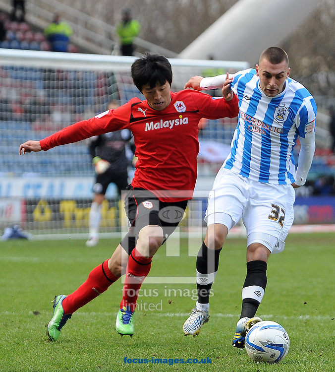Picture by Graham Crowther/Focus Images Ltd +44 7763 140036.09/02/2013.Jack Hunt of Huddersfield Town battles with Kim Bo-Kyung of Cardiff City during the npower Championship match at the John Smiths Stadium, Huddersfield.