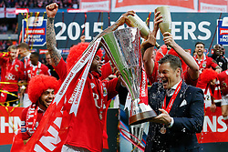Mark Little and Luke Ayling pour champagne over Bristol City Manager Steve Cotterill as he lifts the Football League Trophy after thay win the match 2-0 - Photo mandatory by-line: Rogan Thomson/JMP - 07966 386802 - 22/03/2015 - SPORT - FOOTBALL - London, England - Wembley Stadium - Bristol City v Walsall - Johnstone's Paint Trophy Final.