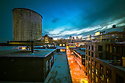 View of water tanks and rooftops with the Manhattan Bridge and the Wall Street skyline in the background, Brooklyn, NY