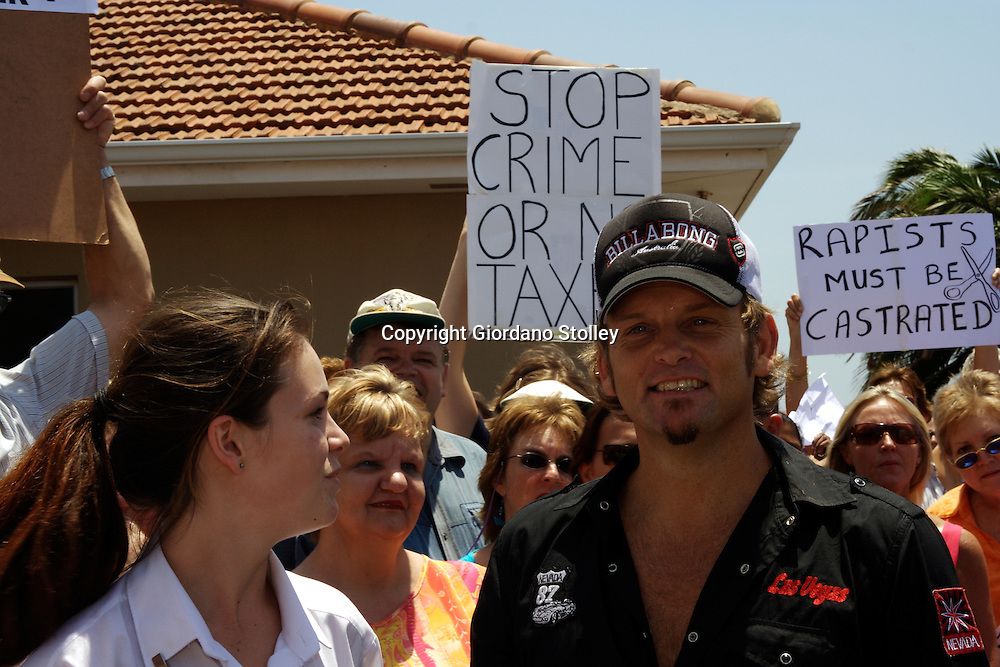 SCOTTBURGH, KWAZULU-NATAL - 23 January 2006 - Popular Afrikaan pop singer Steve Hofmeyr (right) joins protesters at the trial of three men accused of raping three young women outside the Scottsburgh magistrates court. SouthAfrica has one of the highest rates of rape in the world..Picture: Giordano Stolley/Allied Picture Press