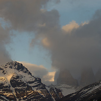 Morning clouds billow over the Towers of Paine & Monte Almirante Nieto (L) in Torres del Paine National Park in Patagonia, Chile.