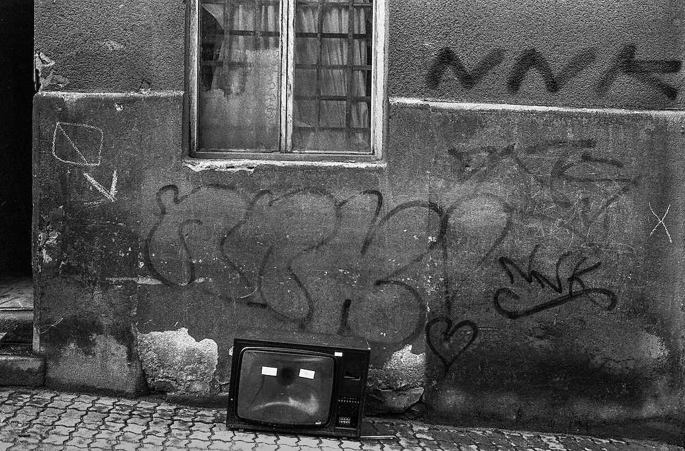 A television standing on a street in Zizkov.