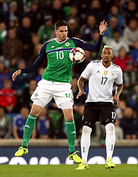 Northern Ireland's Kyle Lafferty and Germany's Jerome Boateng during the 2018 FIFA World Cup Qualifying, Group C match at Windsor Park, Belfast.