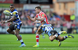 Henry Trinder (Gloucester) offloads the ball after being tackled - Photo mandatory by-line: Patrick Khachfe/JMP - Tel: Mobile: 07966 386802 12/04/2014 - SPORT - RUGBY UNION - Kingsholm Stadium, Gloucester - Gloucester Rugby v Bath Rugby - Aviva Premiership.