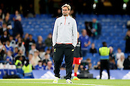 Jurgen Klopp, the Liverpool manager looks on from the pitch before k/o. Premier league match, Chelsea v Liverpool at Stamford Bridge in London on Friday 16th September 2016.<br /> pic by John Patrick Fletcher, Andrew Orchard sports photography.