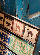 Decorated tiles for sale at a shop in the medina or Essaouira in Morocco