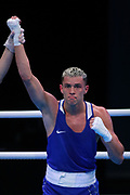 Hugo Micallef of Monaco (bue) celebrates beating Milan Vrankovic of Serbia (not pictured) during The Road to Tokyo European Olympic Boxing Qualification, Sunday, March 15, 2020, in London, United Kingdom. (Mitchell Gunn-ESPA-Images/Image of Sport)