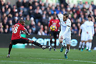 Gylfi Sigurdsson of Swansea city ® goes past Ashley Young of Manchester Utd. Premier league match, Swansea city v Manchester Utd at the Liberty Stadium in Swansea, South Wales on Sunday 6th November 2016.<br /> pic by  Andrew Orchard, Andrew Orchard sports photography.