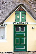Painted door and shutters of traditional thatched cottage house on Fano Island - Fanoe - South Jutland, Denmark