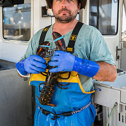Captain Ryan Post on his lobster boat 'Tall Tales', at the Spruce Head Fisherman's Co-op in South Thomaston, Maine.
