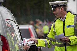 © licensed to London News Pictures. London, UK 29/05/2013. Police officers handing out leaflets, which calling members of the public who witnessed the terrorist attack in Woolwich to contact the police. Photo credit: Tolga Akmen/LNP