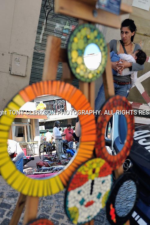 Mother and child at the bustling San Telmo antique market at Plaza Dorrego