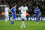 a dejected Bafetimbi Gomis of Swansea city looks on after his team lose 0-5. Barclays Premier League match, Swansea city v Chelsea at the Liberty Stadium in Swansea, South Wales on Saturday 17th Jan 2015.<br /> pic by Andrew Orchard, Andrew Orchard sports photography.