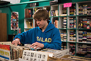 Christian Akridge shops for new vinyl records at a thrift store in Wichita Falls, Texas on November 18, 2015.  (Cooper Neill for Rolling Stone)