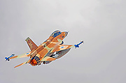 Israeli Air Force (IAF) General Dynamics F-16D in flight with a blue sky background.
