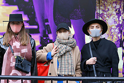 © Licensed to London News Pictures. 14/02/2020. London, UK. Fashion enthusiasts wearing fashionable face masks arrive for the London Fashion Week shows in The Strand. The latest Coronavirus patient in London is linked to 'super spreader'attended transport conference with 250 people in Westminster. Photo credit: Dinendra Haria/LNP