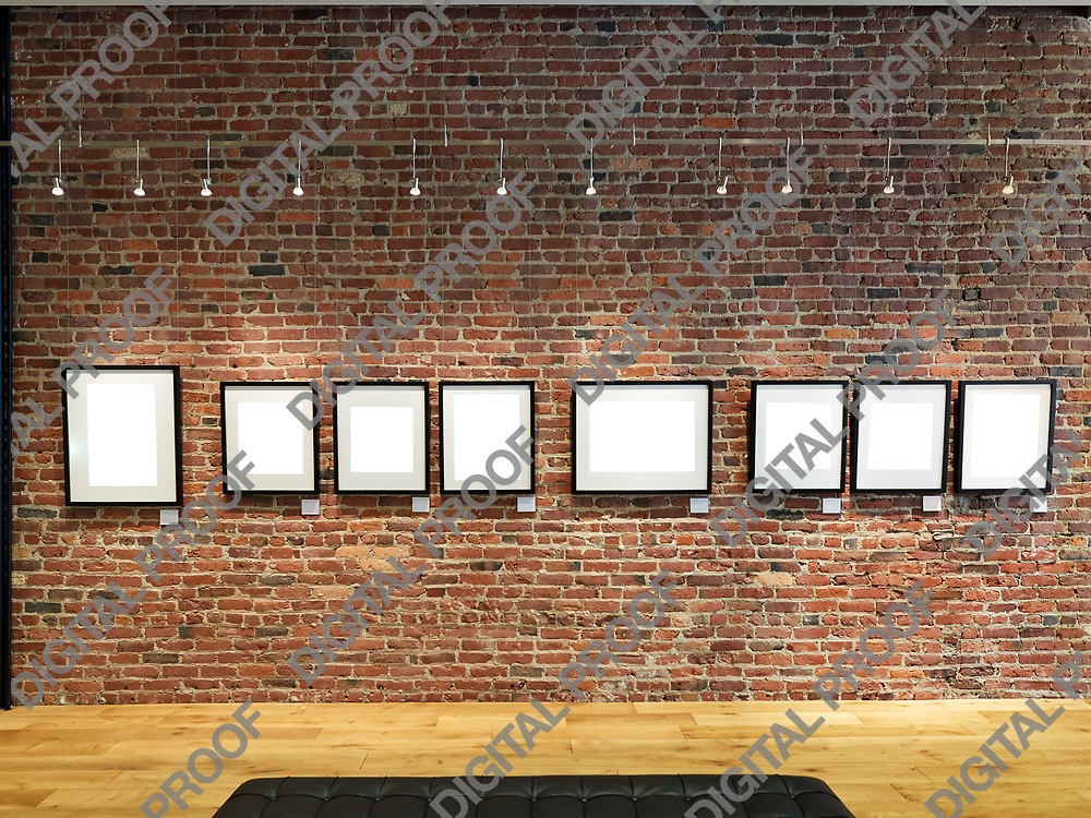Clipping Path photo gallery frames empty on a brick wall