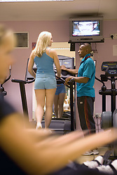 Trainer showing woman how to use the treadmill at Southglade Leisure Centre; Nottingham
