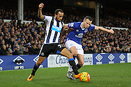 Andros Townsend of Newcastle United and Tom Cleverley of Everton battle for the ball. Barclays Premier League match, Everton v Newcastle United at Goodison Park in Liverpool on Wednesday 3rd February 2016.<br /> pic by Chris Stading, Andrew Orchard sports photography.