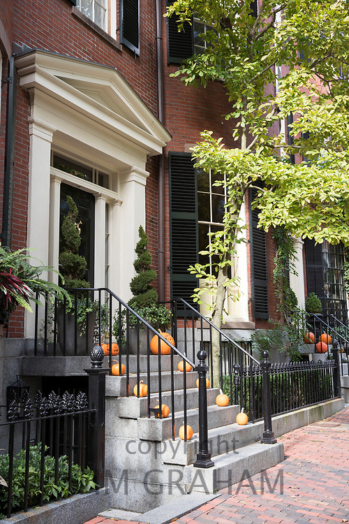 Halloween pumpkins at front door of a home in the Beacon Hill historic district of Boston, Massachusetts, USA