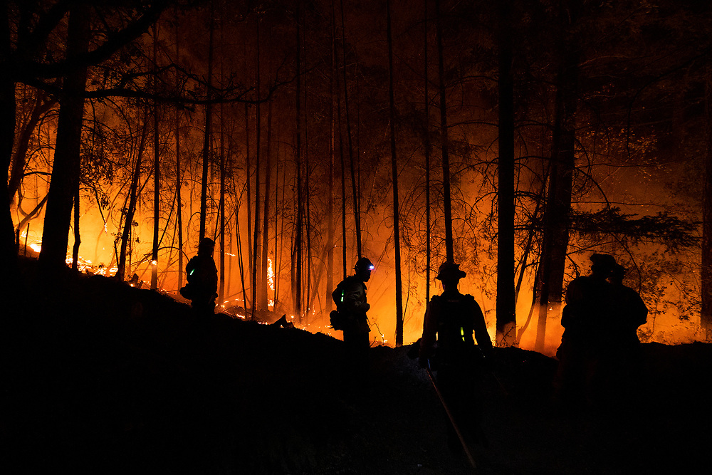 A fire crews monitors a controlled burn to fight the Glass Fire on Highway 29 near Calistoga, Calif. on Oct. 1, 2020.
