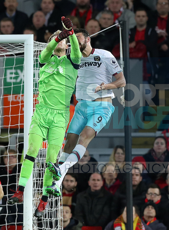 Loris Karius of Liverpool and Andy Carroll of West Ham United clash during the Premier League match at Anfield Stadium, Liverpool. Picture date: December 11th, 2016.Photo credit should read: Lynne Cameron/Sportimage