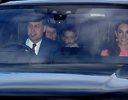 The Duke of Cambridge, Prince George and the Duchess of Cambridge arriving for the Queen's Christmas lunch at Buckingham Palace, London.