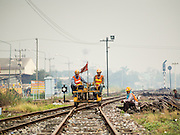 19 MARCH 2015 - AYUTTHAYA, AYUTTHAYA, THAILAND:   Maintenance workers come into the Ayutthaya train station north of Bangkok. The train line from Bangkok to Ayutthaya was the first rail built in Thailand and was opened in 1892. The State Railways of Thailand (SRT), established in 1890, operates 4,043 kilometers of meter gauge track that reaches most parts of Thailand. Much of the track and many of the trains are poorly maintained and trains frequently run late. Accidents and mishaps are also commonplace. Successive governments, including the current military government, have promised to upgrade rail services. The military government has signed contracts with China to upgrade rail lines and bring high speed rail to Thailand. Japan has also expressed an interest in working on the Thai train system. Third class train travel is very inexpensive. Many lines are free for Thai citizens and even lines that aren't free are only a few Baht. Many third class tickets are under the equivalent of a dollar. Third class cars are not air-conditioned.   PHOTO BY JACK KURTZ