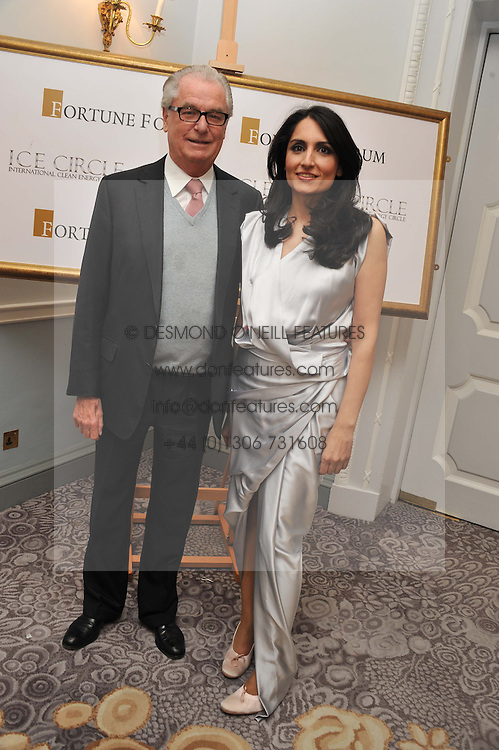 RENU MEHTA and LORD BELL at the 4th Fortune Forum Summit held at The Dorchester Hotel, Park Lane, London on 4th December 2012.