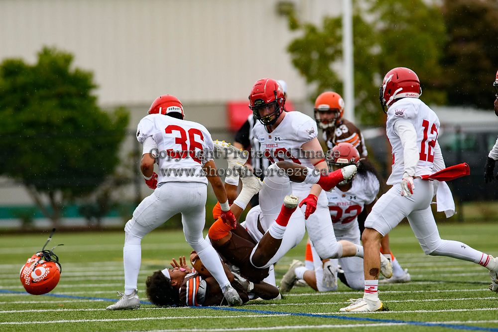 CHILLIWACK, BC - SEPTEMBER 11: Malcolm Miller #3 of Okanagan Sun loses his helmet during a tackle by the Westshore Rebels at Exhibition Stadium in Chilliwack, BC, Canada. (Photo by Marissa Baecker/Shoot the Breeze)