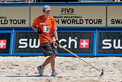 Court boy cleaning the lines of the court at A1 Beach Volleyball Grand Slam tournament of Swatch FIVB World Tour 2011, on August 2, 2011 in Klagenfurt, Austria. (Photo by Matic Klansek Velej / Sportida)
