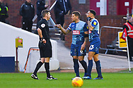 Matthew Donohue (Referee) shows Adam El-Abd of Wycombe Wanderers (6) a red card for pulling Cameron McGeehan of Barnsley (8) hair during the EFL Sky Bet League 1 match between Barnsley and Wycombe Wanderers at Oakwell, Barnsley, England on 16 February 2019.