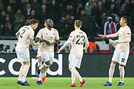 GOAL - Manchester United Forward Romelu Lukaku celebrates with Manchester United Defender Victor Lindelof and Manchester United Defender Chris Smalling 0-1 during the Champions League Round of 16 2nd leg match between Paris Saint-Germain and Manchester United at Parc des Princes, Paris, France on 6 March 2019.