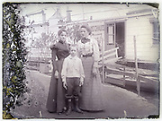 two adult females and young boy in front of houseboat Paris early 1900s
