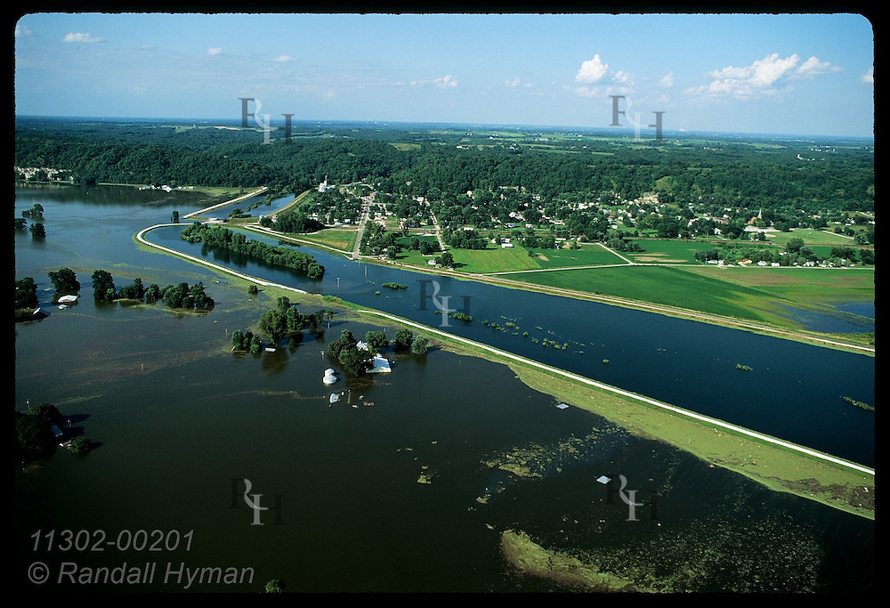 Aerial: Mississippi River on 8/3/93 nearly tops levee of state's oldest town, Prairie du Rocher. Illinois