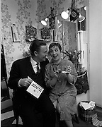 "03/01/1969.01/03/1969.03 January 1969.Maureen Potter, star of the pantomime ""Tom Thumb"", reads birthday cards and greetings messages in her dressing room at the Gaiety Theatre, just before curtain-up. A party was given for her on the stage after the show on Saturday 4th. Maureen had stared in the pantomime on 25 of her birthdays in the previous 27 years. A birthday hug for Maureen Potter star of the Panto ""Tom Thumb"", from guest star Ray McAnally at the Gaiety Theatre. Ray played two roles - a clown and a giant - in the panto. In one scene he presents Tom with an apple. For her birthday Ray presented Maureen with a gold pendant in the form of a miniature apple."