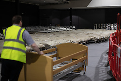 © Licensed to London News Pictures. 11/04/2020. Manchester, UK. Beds are assembled in the venue canteen . The National Health Service is building a 648 bed field hospital for the treatment of Covid-19 patients , at the historical railway station terminus which now forms the main hall of the Manchester Central Convention Centre . The facility is due to open on Easter Monday , 13th April 2020 , and will treat patients from across the North West of England , providing them with general medical care and oxygen therapy after discharge from Intensive Care Units . Photo credit: Joel Goodman/LNP