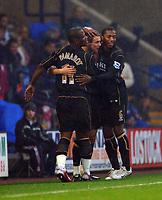 Photo: Paul Greenwood.<br />Bolton Wanderers v Portsmouth. The Barclays Premiership. 30/12/2006. Pompey's Matthew Taylor is congratulated by Noe Pamarot, left and Manuel Fernandes