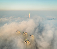 Aerial view of skyscrapers and Almas tower in the clouds of Dubai, U.A.E