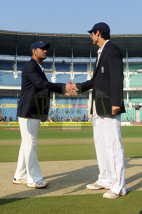 MS Dhoni captain of India (R)and Alastair Cook captain of England during the toss before the start of the match on day one of the 4th Airtel Test Match between India and England held at VCA ground in Nagpur on the 13th December 2012..Photo by  Pal Pillai/BCCI/SPORTZPICS .