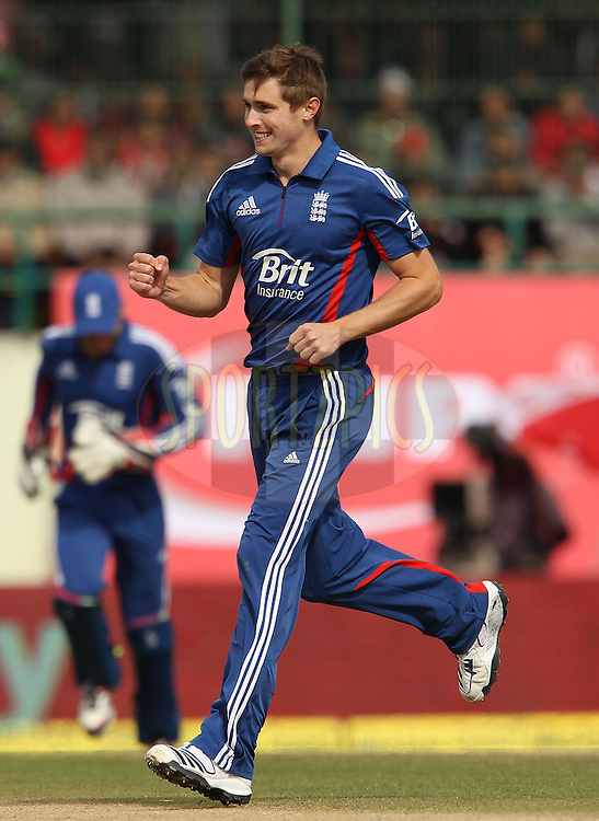 Chris Woakes of England celebrates the wicket of Suresh Raina of India during the 5th Airtel ODI between India and England held at the HPCA Stadium in Dharamsala, Himachal Pradesh, India on the 27th January 2013..Photo by Ron Gaunt/BCCI/SPORTZPICS ..Use of this image is subject to the terms and conditions as outlined by the BCCI. These terms can be found by following this link:..http://www.sportzpics.co.za/image/I0000SoRagM2cIEc