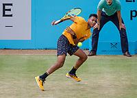 Tennis - 2019 Queen's Club Fever-Tree Championships - Day Six, Saturday<br /> <br /> Men's Singles, Semi Final: Felix Auger-Aliassime (CAN) Vs. Feliciano Lopez (ESP)<br /> <br /> Felix Auger-Aliassime (CAN) in action on Centre Court.<br />  <br /> COLORSPORT/DANIEL BEARHAM
