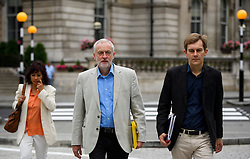 © Licensed to London News Pictures. 10/07/2016. London, UK. Labour Party Leader JEREMY CORBYN arrives at the BBC Broadcasting House in London with his wife LAURA ALVAREZ and Director of Strategy SEUMAS MILNE, to appear on the Andrew Marr Show on July 10, 2016.  Photo credit: Ben Cawthra/LNP