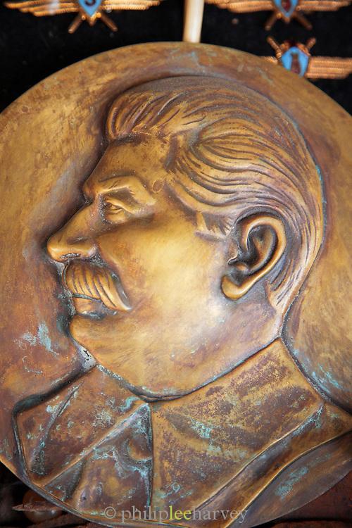 Detail of a Stalin bronze plague for sale by street vendor selling Soviet Era memorabilia, Khabarovsk.Siberia, Russia