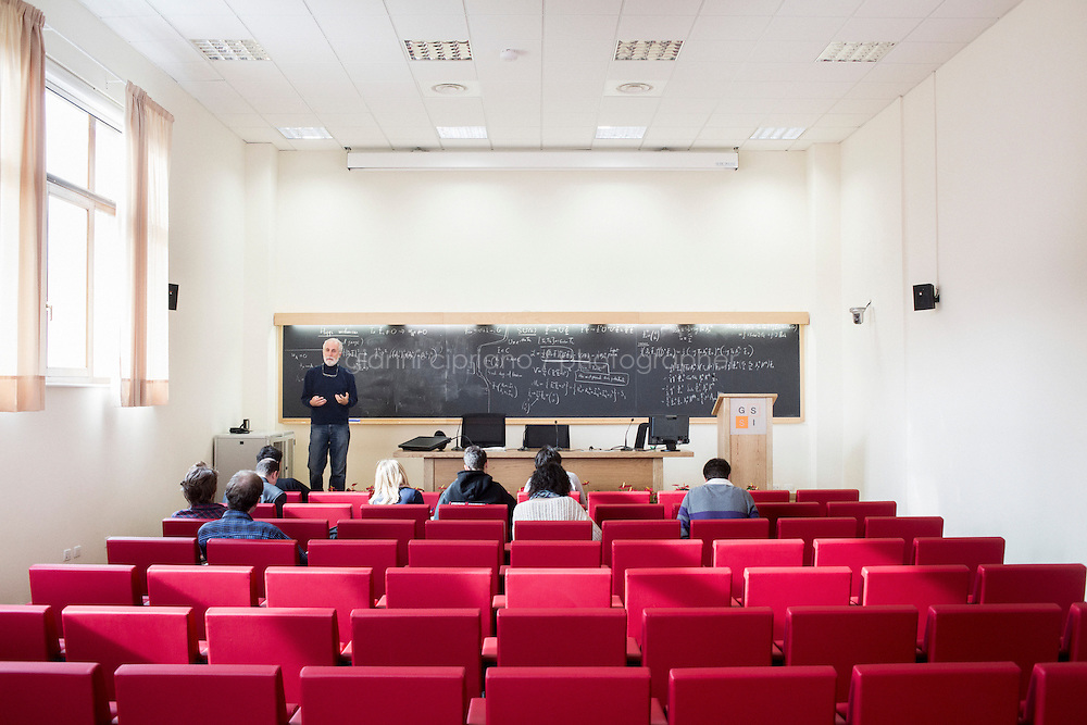 L'AQUILA, ITALY - 18 November 2013: Theoretical physicist Goran Senjanovic, 63, gives a physics lesson in the auditorium of the Gran Sasso Science Institute in L'Aquila, Italy, on November 13th, 2013. <br /> <br /> The first accademic year of the Gran Sasso Science Institute was inaugurated last week in L'Aquila. The GSSI, which has selected 36 students this years, is an international PhD school and a center for advanced studies in physics, mathematics, computer science and social sciences. Its purpose is to form high level human capital, integrating education and research in a lively interdisciplinary environment.<br /> <br /> The city of L'Aquila was struck by 6.3 Richter scale earthquake on April 6th, 2009. The earthquake was felt throughout central Italy; 297 people are known to have died,making this the deadliest earthquake to hit Italy since the 1980 Irpinia earthquake.
