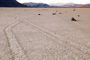 Many rocks sit on the playa at the Racetrack in Death Valley National Park. The tracks show where the rocks moved along the floor of the valley - a phenomenon that is yet unexplained.