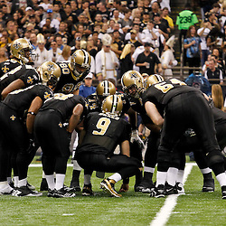 January 7, 2012; New Orleans, LA, USA; New Orleans Saints quarterback Drew Brees (9) huddles with his team against the Detroit Lions during the 2011 NFC wild card playoff game at the Mercedes-Benz Superdome. Mandatory Credit: Derick E. Hingle-US PRESSWIRE